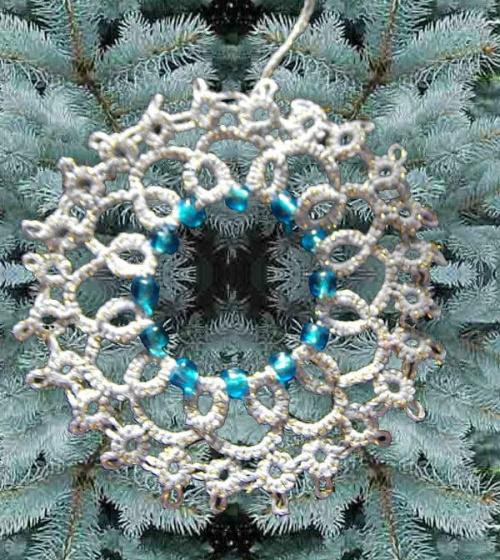 biało zlota gwiazdka z jasno niebieskimi koralikami